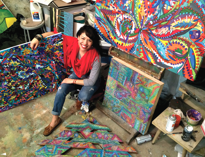 Ines Alvidres poses with some of her work, left, which will be on display at Finder's Fayre Antiques, beginning April 4. ISSUE photo by Andy Coughlan