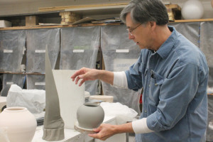 Linnis Blanton shows off a three-piece construction in progress. ISSUE photo by Jacqueline Hays