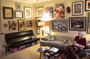 Tam Kiehnhoff works on a quilt in her Houston home surrounded by her collection of Texas art, just a small part of her eclectic collection.