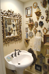 Even the bathroom is Tam Kiehnhoff's house displays her eclectic art collection.
