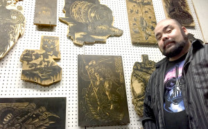 Jake Abelman with a few of the woodblocks that form his prints.