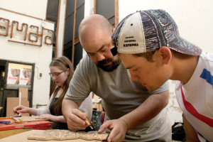 Maurice Abelman works with a student during a workshop in Estonia in summer 2015.
