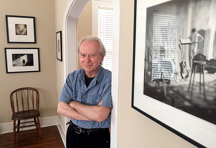 """Dennis Kiel's Old Town Beaumont home is lined with photographs he has collected —all immaculately hung, of course. The photograph in the near photo is by Keith Carter and is titled """"Studio."""""""