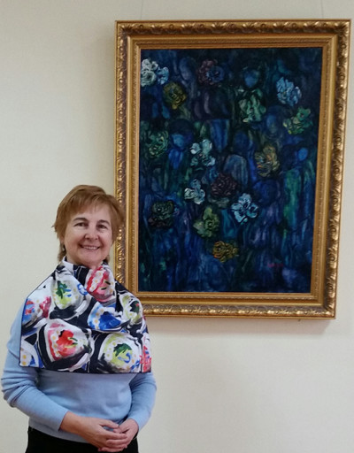 Elena Ivanova, above, stands next to Standing Next to a Zarfin painting and wearing a scarf after Zarfin's design.