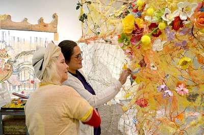 "Artist Ann Wood, left, and curator Sarah Beth Wilson install Wood's ""Curtain Call"" exhibition at the Art Museum of Southeast Texas."